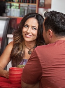 Skeptical Woman Looking at Man in Cafe